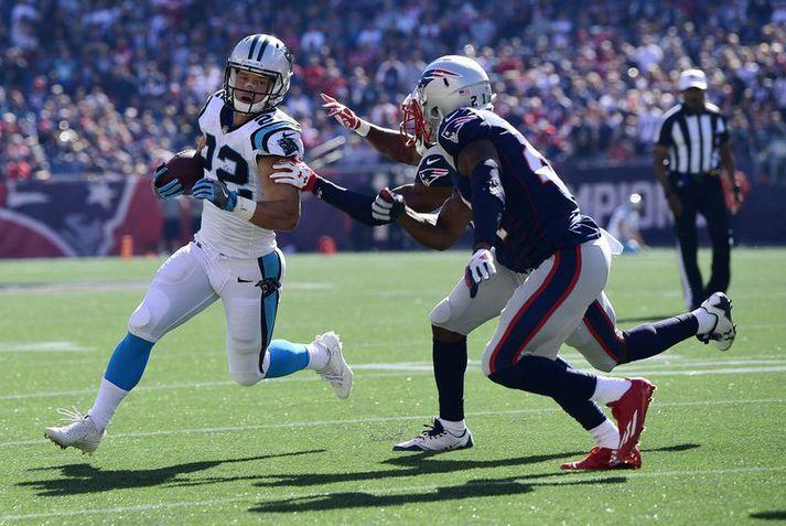 Christian McCaffrey á fullri ferð með Carolina Panthers liðinu í leik á móti New England Patriots.