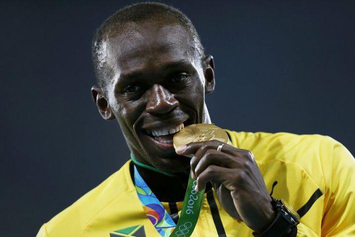 Usain Bolt vann átta Ólympíugull á sínum ferli. Hér bítur hann í eitt þeirra.