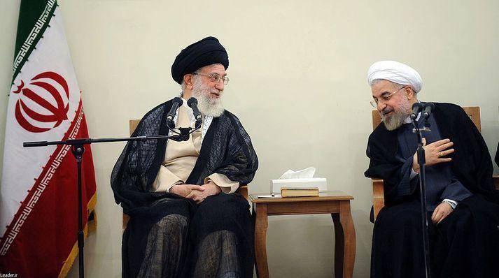 Ali Khamenei , æðsti leiðtogi Íran, og Hassan Rouhani, forseti landsins.
