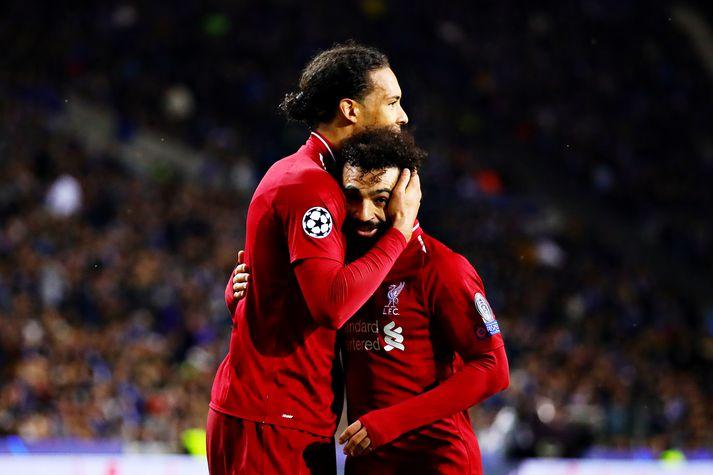 Virgil og Salah fagna í kvöld.