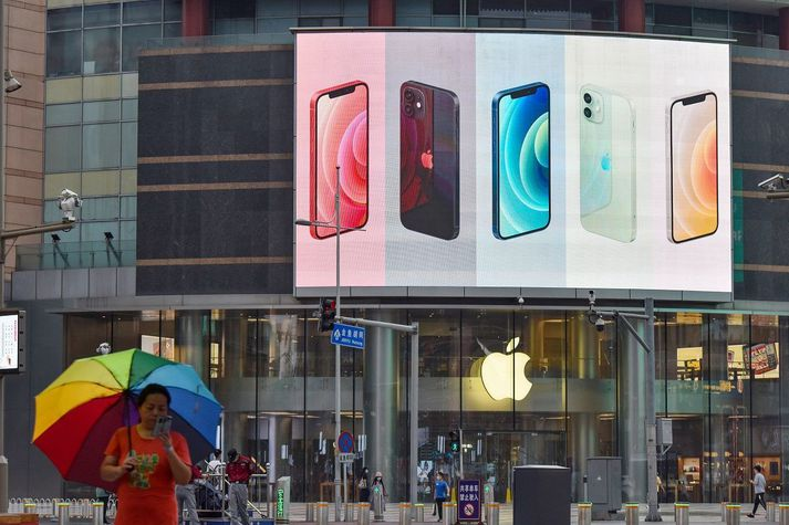 iPhone smartphones seen displayed on a large screen outside