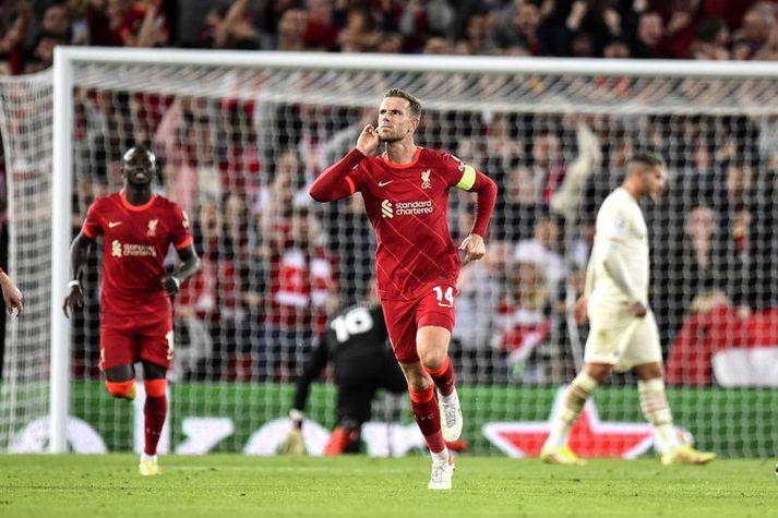 Jordan Henderson fagnar sigurmarki sínu fyrir Liverpool í gær.