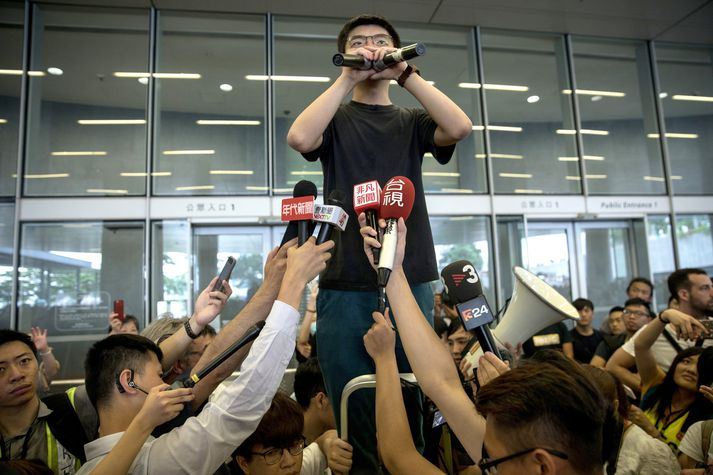 Mótmælt í Hong Kong. Á myndinni má sjá Joshua Wong, aðgerðasinni stúdenta á mótmælunum.