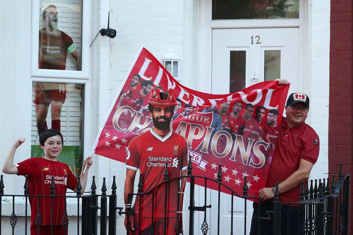 Stuðningsmenn Liverpool fagna Englandsmeistaratitlinum um allan heim í kvöld.