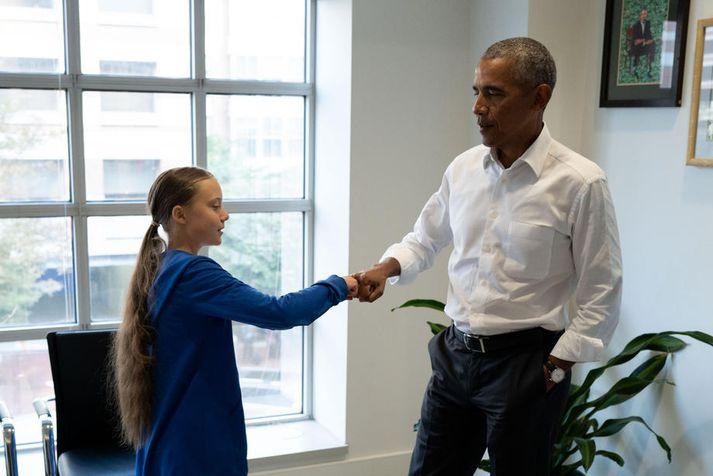 Obama sagði Thunberg að þau væru saman í liði þegar þau gáfu hvor öðru kumpánlega kveðju.