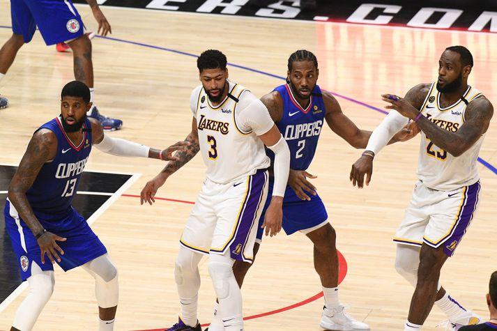 Þessar fjórar ofurstjörnur NBA-deildarinnar (Paul George, Anthony Davis, Kawhi Leonard og LeBron James) eru allar á leiðinni í Disney World saman.