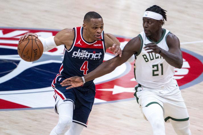 Þessir tveir áttu góða leiki í nótt. Jrue Holiday tryggði Bucks sigur á meðan Russell Westbrook var eini leikmaður Wizards með lífsmarki í stóru tapi.