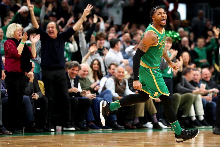 Marcus Smart fagnar hér einni af körfum sínum í sigri Boston Celtics í nótt.