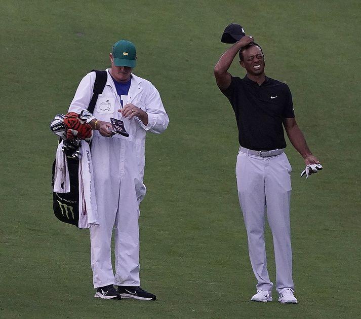 Tiger Woods þarf að spýta í lófana ef hann ætlar að verja græna jakkann.