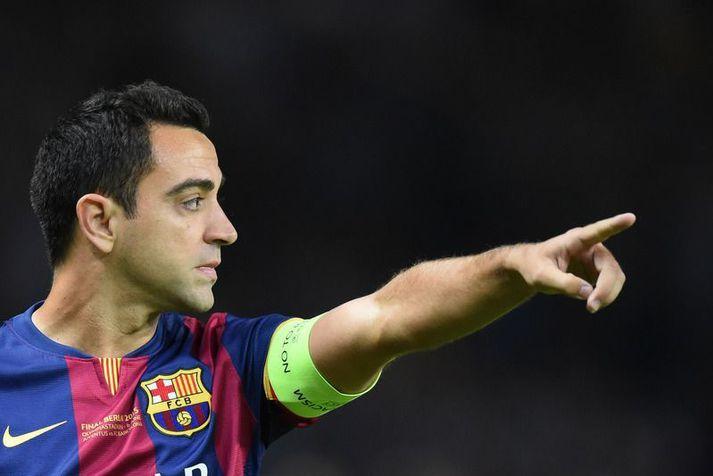Xavi Hernandez í leik með Barcelona þar sem hann spilaði í sautján ár með meistaraflokksliðinu.