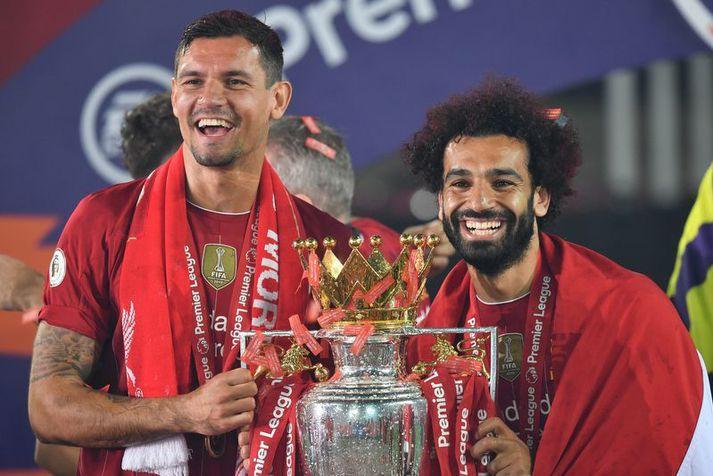 Dejan Lovren fagnar enska meistaratitlinum með Mohamed Salah síðasta sumar.