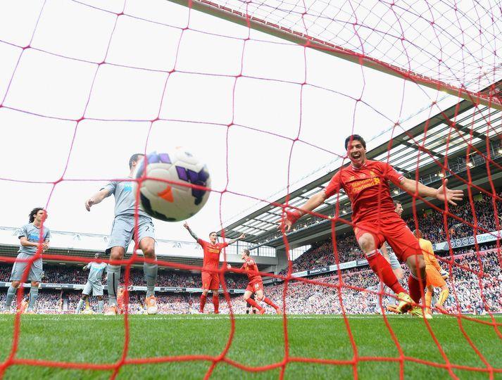 Luis Suarez fagnar marki með Liverpool þar sem hann spilaði á árunum 2010 til 2014 og varð að heimsklassa framherja.