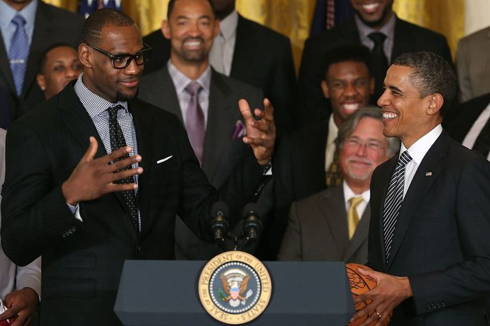 LeBron James heimsótti Barack Obama í Hvíta húsið eftir að Miami Heat vann NBA titilinn en mun aldrei mæta til Donald Trump.