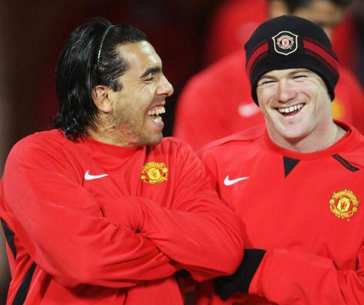 Tevez og Rooney léttir í bragði.