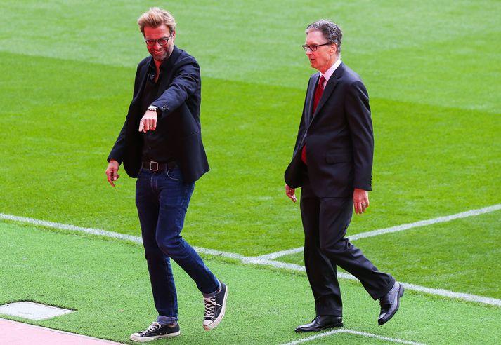 Jürgen Klopp, knattspyrnustjóri Liverpool, og John W. Henry, eigandi félagsins. Jamie Carragher segir engan vafa liggja á því hvor þeirra sé kóngurinn hjá Liverpool.