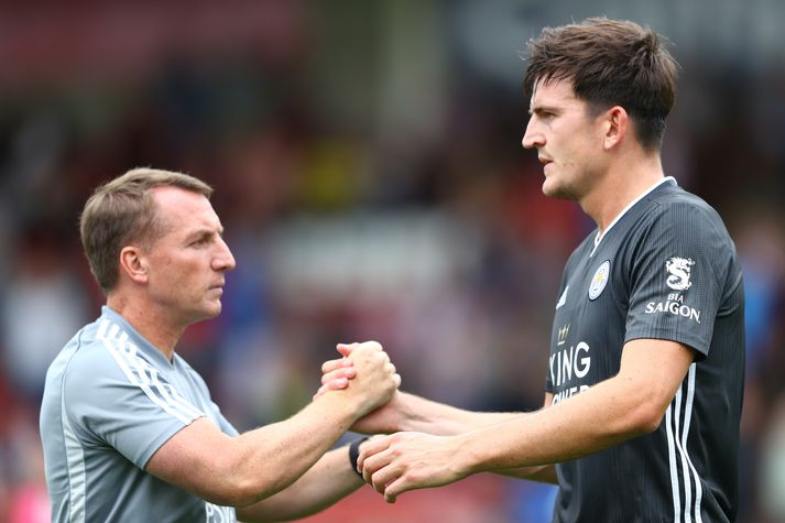 Brendan Rodgers og Harry Maguire.