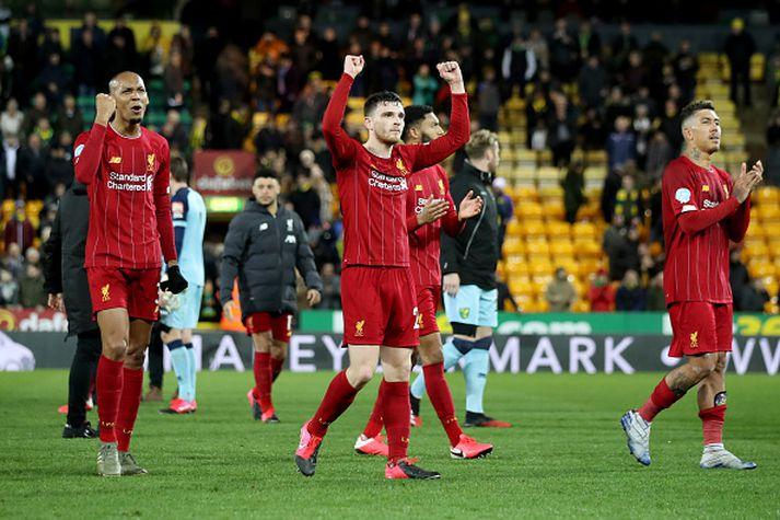 Leikmenn Liverpool fagna sigrinum gegn Norwich um helgina.