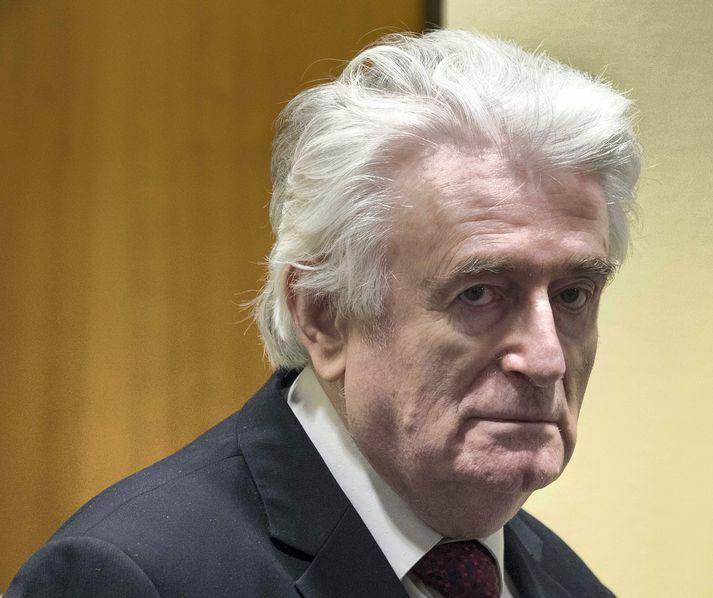 Karadzic er sagður ekki hafa sýnt svipbrigði þegar dómurinn var kveðinn upp í Haag í dag.