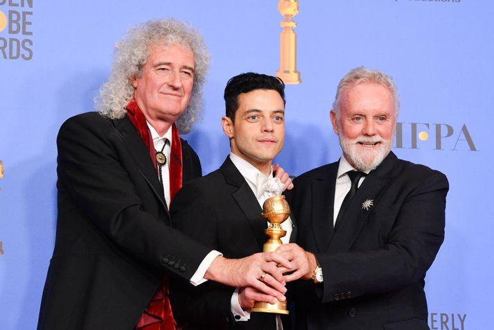 Rami Malek sést hér í miðjunni ásamt Brian May og Roger Taylor úr Queen.