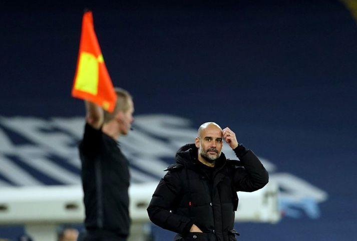 Pep Guardiola á hliðarlínunni í dag.