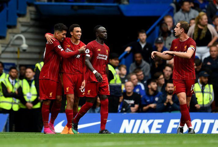 Liverpool fagnar fyrra marki sínu í dag.