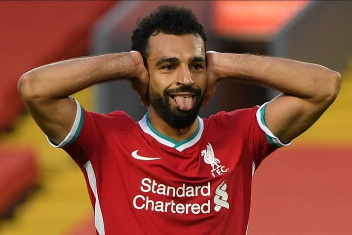 Mohamed Salah fagnar marki með Liverpool.