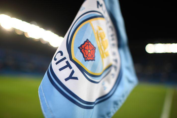 Manchester City slapp við félagaskiptabann.