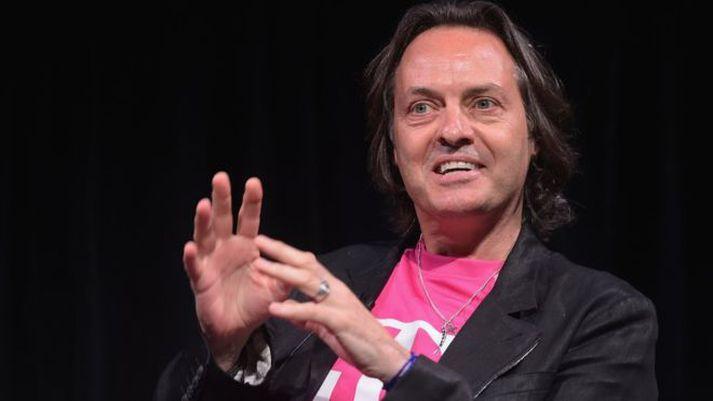 John Legere, forstjóri T-Mobile, er spenntur fyrir samrunanum.
