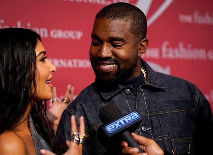 Kanye West ásamt eiginkonu sinni Kim Kardashian.