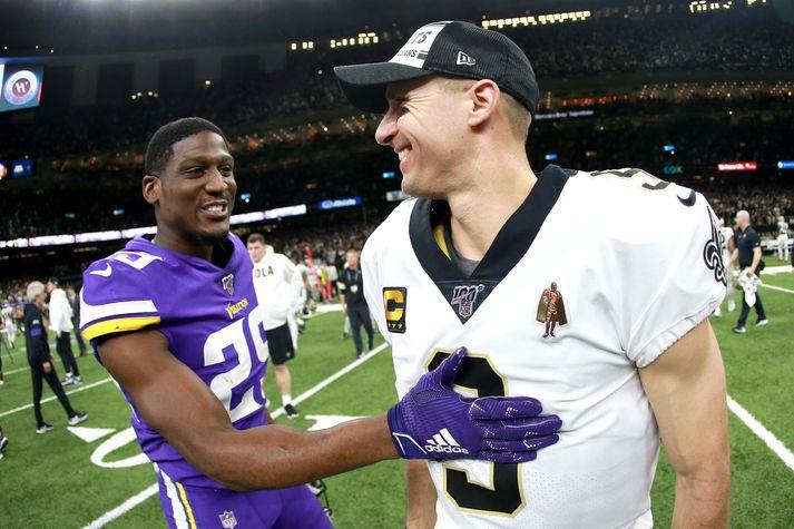 Xavier Rhodes (t.v.) og Drew Brees ræða málin að loknum leik Minnesota Vikings og New Orleans Saints.